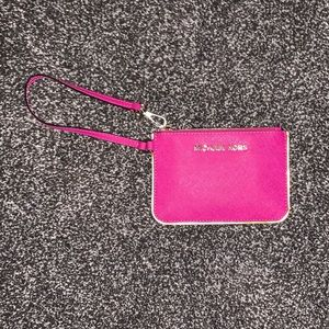 Pink Michael Kors wristlet wallet
